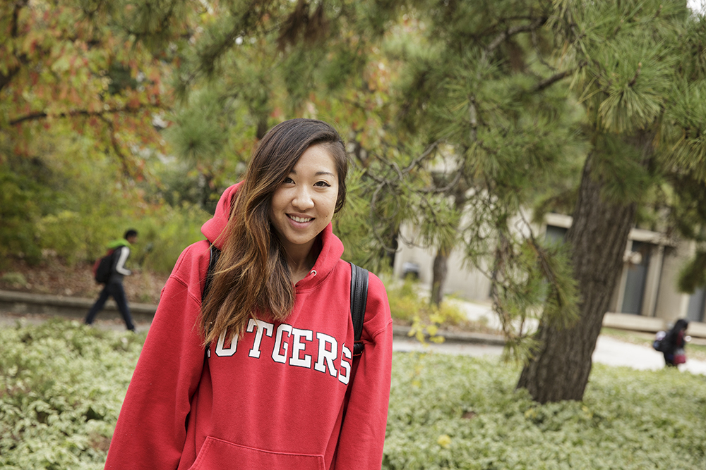 female Rutgers student in Rutgers gear