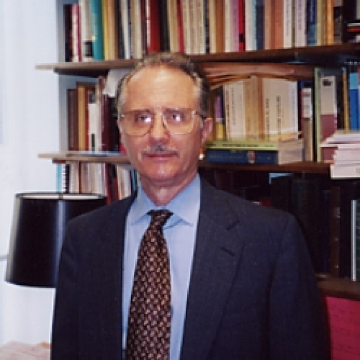 Dr. Peter Golden standing in front of bookcase