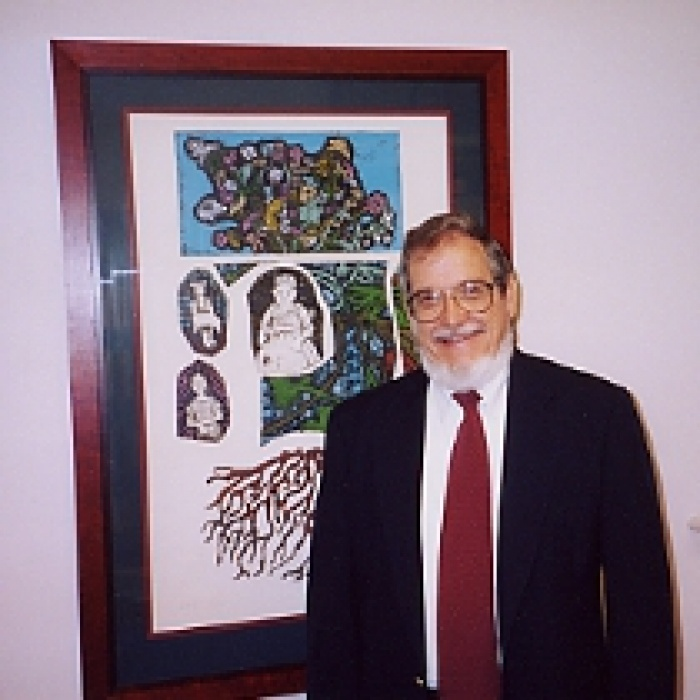 Dr. David Hosford standing in front of painting