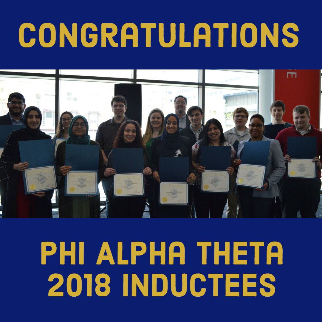 Fifteen 2018 Phi Alpha Theta Inductees showing their induction certificates.