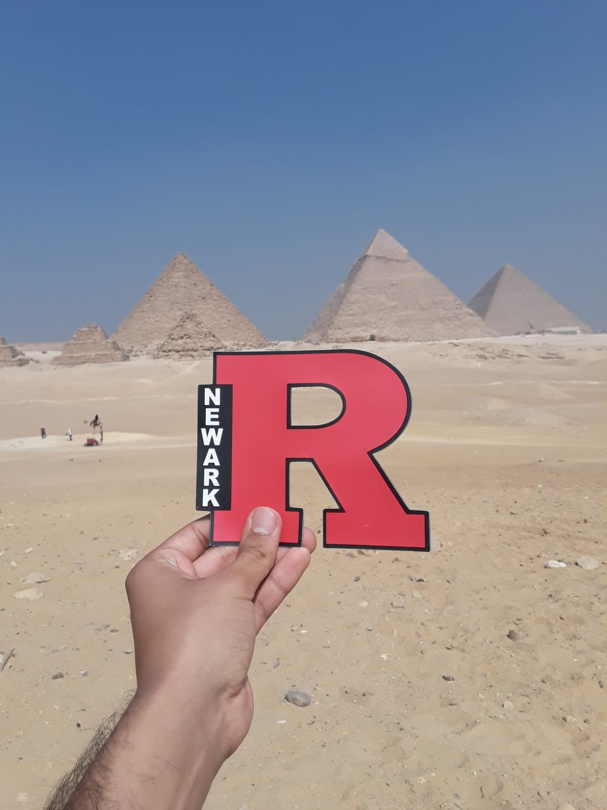 R-sticker in front of Pyramids in Giza