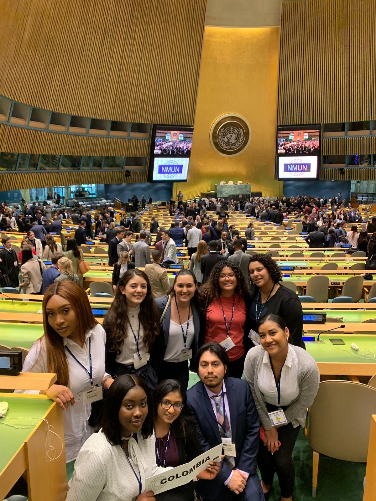 Student delegates pose inside the UN headquarters in New York City