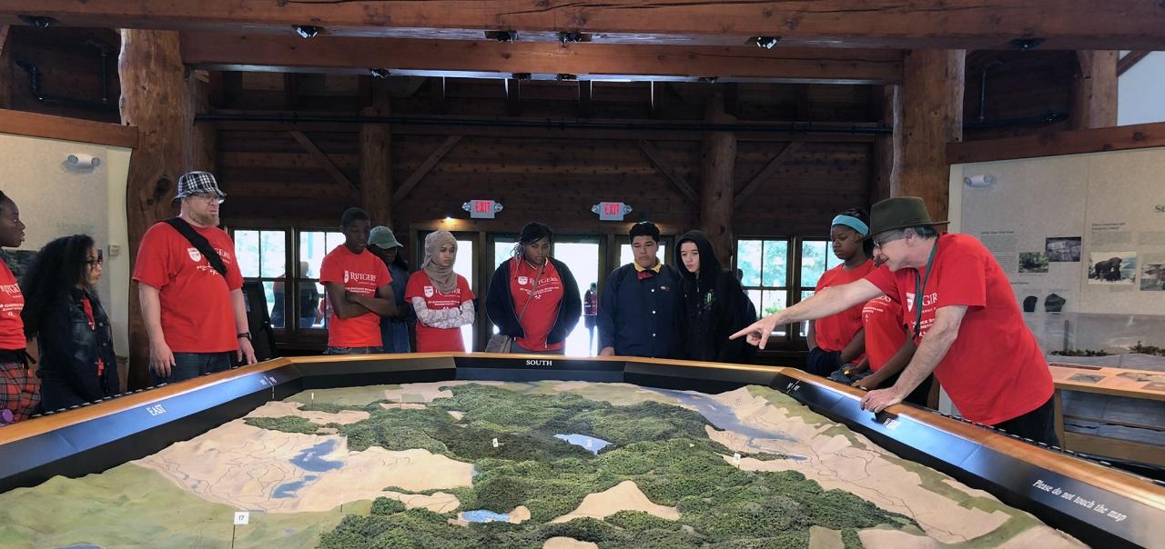 Professor Alec Gates and Geoscience Summer Scholars stand around large-scale model