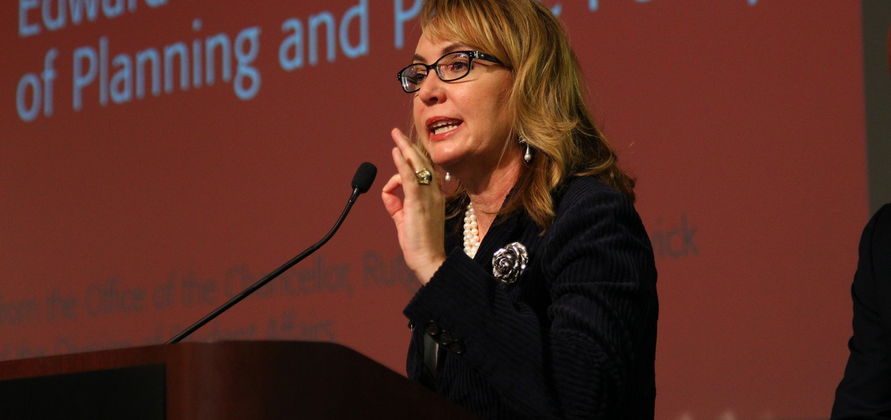 Gabby Giffords speaking at the podium