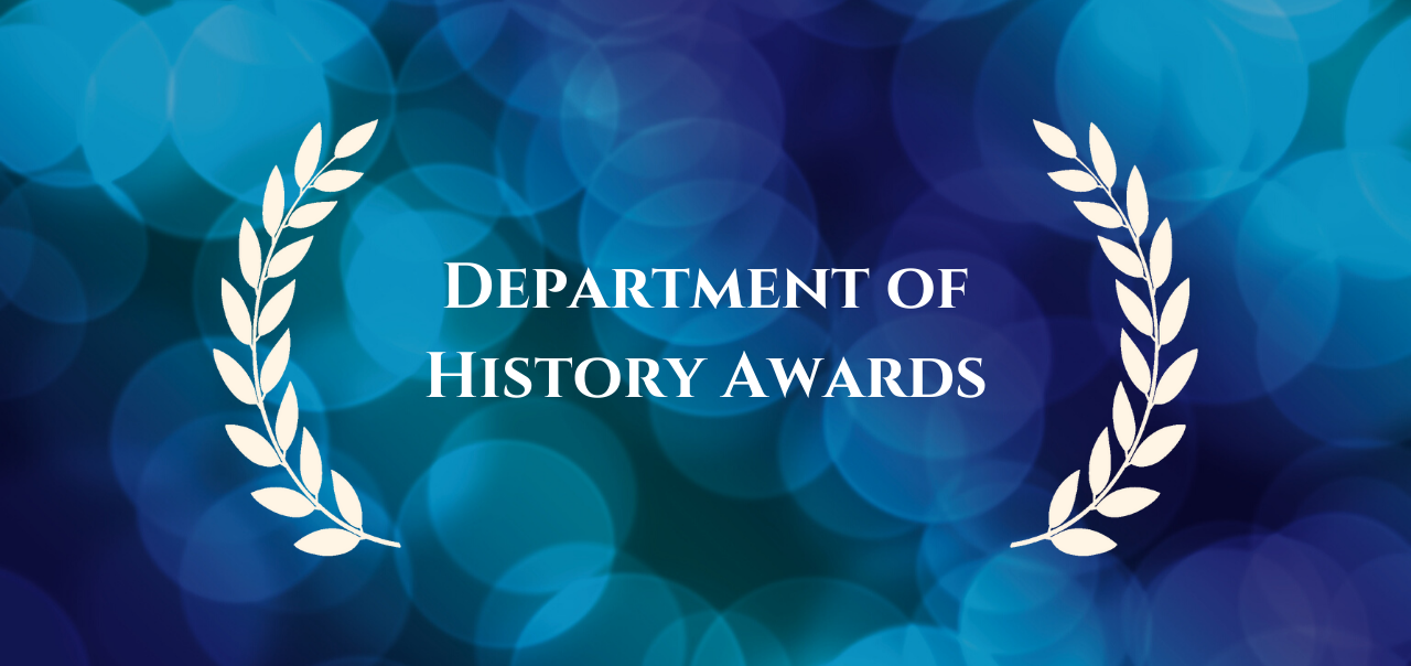 """Department of History Awards"" centered with outlines of laurels on either side in front of a background of blurry blue lights."