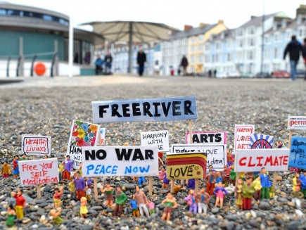 protest signs on gravel