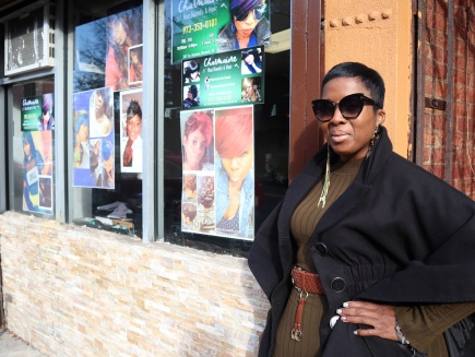 Charmaine Vann Seagraves, owner of Charmaine Has Hands 4 Hair, outside of her salon.
