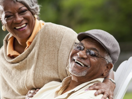 African American male and female seniors laughing