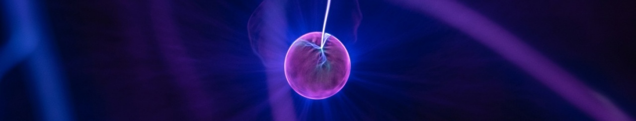Glowing purple ball on dark background. Image courtesy: Unsplash