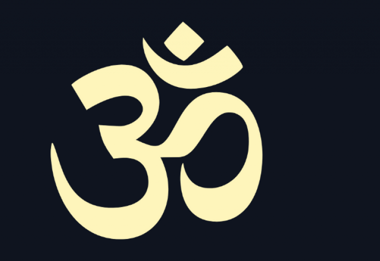 A beige symbol of Hinduism over a black background.
